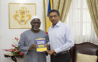 President Faure receives a copy of book The Seychellois Writers by local writer Abdourahamane Diallo