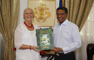 "President Faure presented with the first copy of ""Tropical plants in Seychelles"""