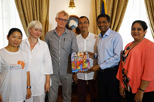 "President Faure presented with first copy of ""Art in Seychelles Then and Now"""