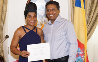 President Faure Welcomes Gold Medallist Female Weightlifter Clementina Agricole