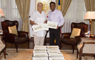 President receives artistic impressions of Old Seychelles from artist Alexandra Azaïs